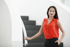 Portrait of young businesswoman on office stairs Stock Photos