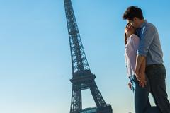 Young couple embracing near Eiffel Tower, Paris, France Stock Photos