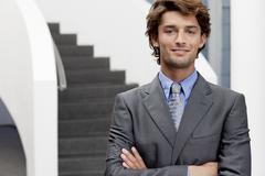 Portrait of businessman in office atrium - stock photo