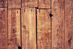 Old film stylized old wooden boards background - stock photo