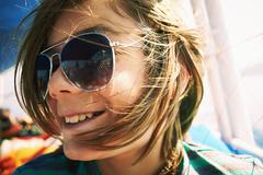 Close up candid portrait of boy in sunglasses - stock photo