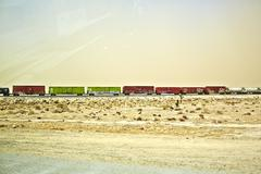 Freight locomotive moving through arid landscape, California, USA - stock photo