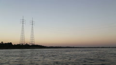 Electric pylons on the Nile at sunset Stock Footage