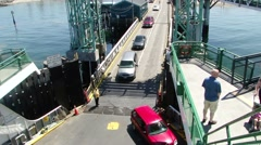 Passenger cars drive onto the Washington State ferry Stock Footage