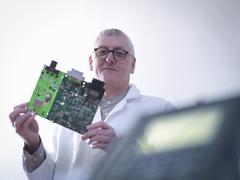 Portrait of engineer designing electronic circuitry for automotive use - stock photo