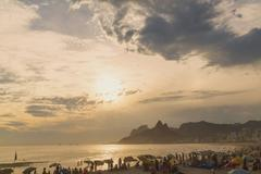 Holiday makers on beach at Ipenema, Rio De Janeiro, Brazil - stock photo