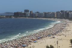 Crowds of holiday makers on Ipanema beach, Rio De Janeiro, Brazil - stock photo