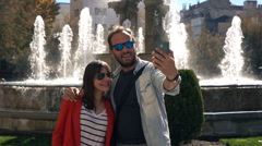 Young couple taking selfie photo with cellphone by fountain, super slow motion 2 Stock Footage