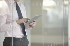 Businessman suing digital tablet Stock Photos