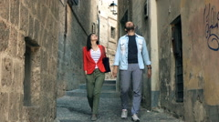 Happy couple talking and sightseeing old town, super slow motion 120fps Stock Footage