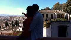 Silhouette of couple admiring cityscape view, super slow motion 120fps - stock footage