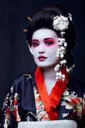 Young pretty geisha in kimono with sakura and decoration Stock Photos