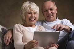 Older couple and new technology - stock photo