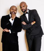 two afro-american businessmen in black suits emotional posing, gesturing - stock photo