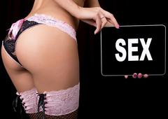 Technology, internet and networking - close-up ass of girl in lacy lingerie Stock Photos