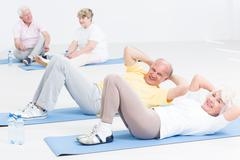 Exercising together gives them lots of fun in old age Stock Photos