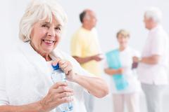 Needs to refresh herself after satisfying series of exercise Stock Photos