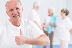Little bit of exhausting exercise makes him fit in old age - stock photo
