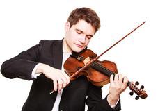 Man violinist playing violin. Classical music art Kuvituskuvat