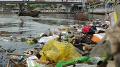 Water pollution with rubbish in Mekong River Stock Footage