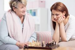 Check-mate! Grandma wins! Stock Photos