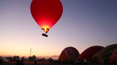 Hot air ballooning in Luxor over the Valley of the Kings and Nile river. Stock Footage
