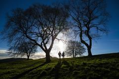 A young couple hold hands on Calton Hill in Edinburgh, capital of Scotland Stock Photos