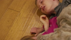 Young siblings wrestling and play fighting in the kitchen at home Stock Footage