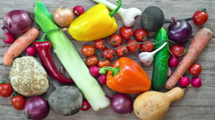 Vegetables on wooden background, stop motion animation, 4K. Stock Footage