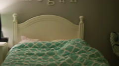 A woman turning off the lights in her daughter's bedroom Stock Footage