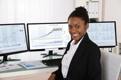 Photo Of Young African Stock Broker In Office - stock photo