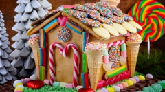 Festive Christmas Gingerbread House decorated with candy canes, marshmallow c - stock footage
