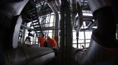 4K Large team of engineers at work in power station Stock Footage