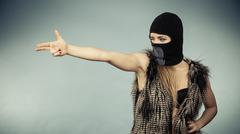 Woman sexy girl in balaclava, crime and violence - stock photo