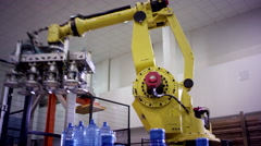 clear water robot in the factory of pure water - stock footage