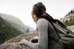 Young woman looking at view, Squamish, British Columbia, Canada - stock photo