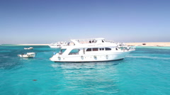 Tour boats anchored next to Paradise island in the Red sea, Egypt Stock Footage