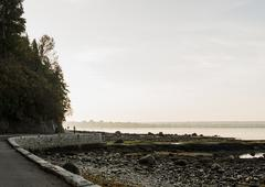 Solitary runner on waterfront road, Vancouver, Canada - stock photo