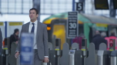 4k Attractive serious businessman walking through busy London train station.  Stock Footage