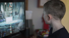 A little boy playing games on a computer in his room Stock Footage