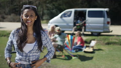 4K Portrait of smiling hipster girl with friends at music festival campsite - stock footage
