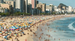 Crowded Ipanema Beach full of people in Rio De Janeiro, Brazil Stock Footage