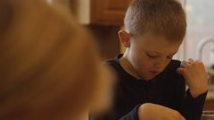A little boy eating pancakes with his hands Stock Footage