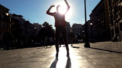 Silhouette of woman dancing in city, super slow motion 240fps - stock footage