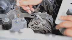 Hands of man using a wrench to tighten the nut at the motor starter - stock footage