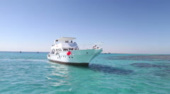Crew members anchoring the boat next to Paradise island in the Red sea Stock Footage