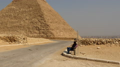 Zoom Out - Security Guard and Pyramid of Giza - Egypt - stock footage