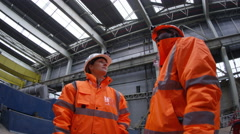 4K Female foreman in power station & discussing operations with male colleague Stock Footage