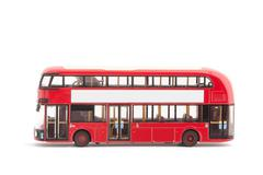 Miniature model of a modern red london bus on a white background Kuvituskuvat