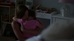 A little girl giving her mom a big hug in the morning after waking up Stock Footage